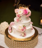 wedding cake three layers fresh ranunculus rose flowers with gold love calligraphy cake topper
