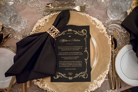 Wedding reception ornate gold charger plate with menu card gold foil gold border with napkin