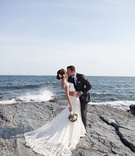 John Colaneri, co-host of Kitchen Cousins, kisses his bride by the water in Newport, RI