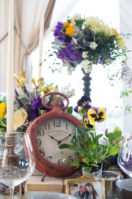 table decor clock purple yellow flowers new york city bridal shower pre wedding trinkets photo