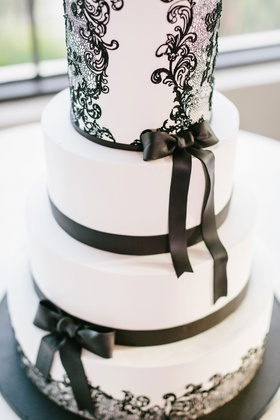 Wedding cake fondant with black bow detail and lace design swirl contemporary modern cake ideas