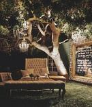 Hollywood Glamour-style seating and chandeliers