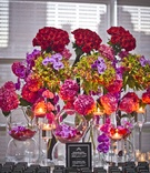 red roses, purple orchids, pink hydrangeas, black escort cards and white ink