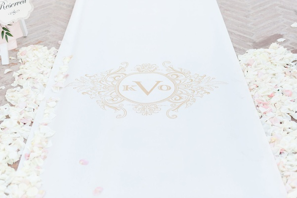 The Original Runner Company white aisle runner with gold monogram flower petals on both sides