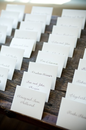 White place cards with brown handwritten names