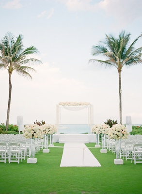 White chairs and aisle leading to wedding canopy