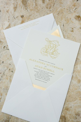 vera wang for paper source invitations with gold lettering and monogram