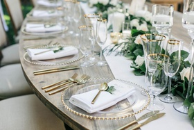 Wedding reception jillian murray and dean geyer wood table with gold flatware clear charger plates