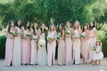 bridesmaids in mismatched nude and blush bridesmaid dresses, bride in monique lhuillier