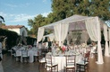 White reception tent covers tables in backyard