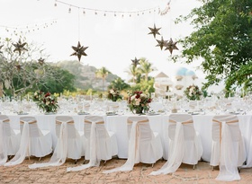Wedding rehearsal dinner in Mexico destination welcome party white chair covers star lanterns