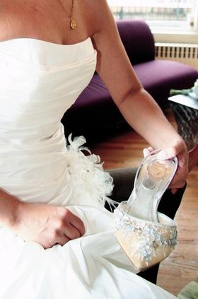 Bride holding René Caovilla wedding heels