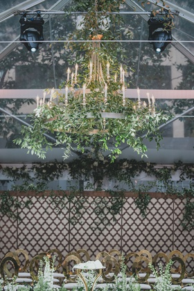 wedding ceremony alfresco tented wedding with chandelier greenery gold guest chairs modern luxury