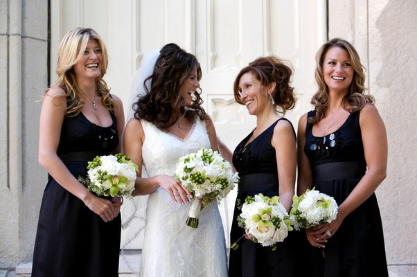 Black bridesmaid dresses and small nosegays