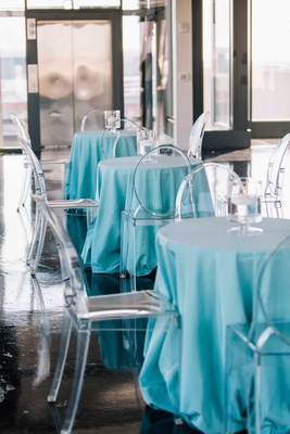 matthew stafford rehearsal dinner tiffany blue small tables with ghost chairs