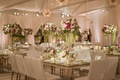 Wedding reception mirror gold table with white chairs and tall flower arrangements amaranthus red