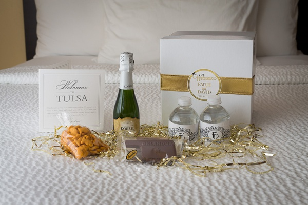 wedding welcome box with mini water bottles, champagne, goldfish crackers
