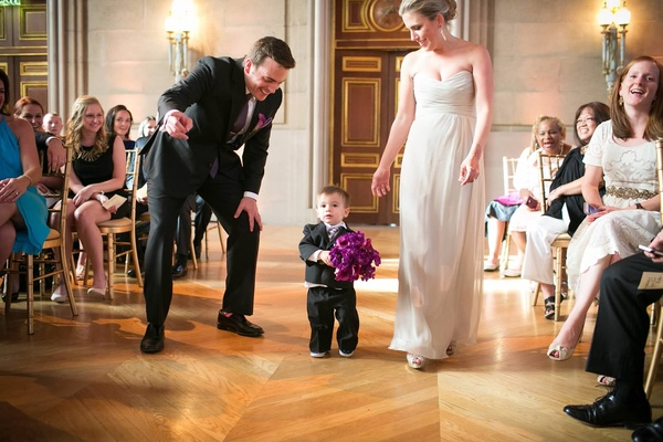 ring bearer with bridesmaid and groomsman carries