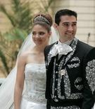 Groom in Charro suit and bride in tiara