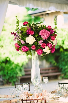 Tall wedding reception centerpiece pink flowers rose hydrangea peony green leaves rose gold candles