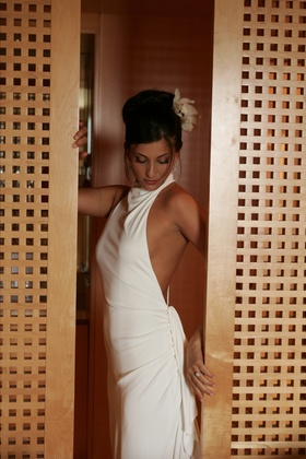 Bride in high neck wedding dress with open back