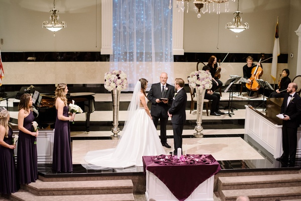 Wedding ceremony at Baptist church bridesmaids and groomsmen string quartet officiant