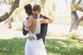 Bride in Mira Zwillinger wedding dress from Carine's Bridal Atelier low v-back high bun hugs groom