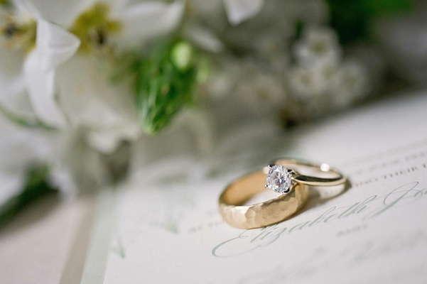 Gold hammered men's band and solitaire engagement ring