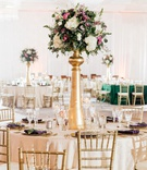 round wedding reception table tall gold centerpiece white hydrangea pink purple rose flowers gold