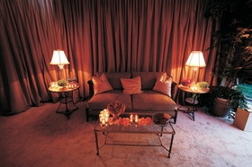 Wedding lounge area with amber draping and tan sofa