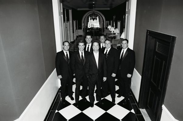 Black and white photo of wedding party men