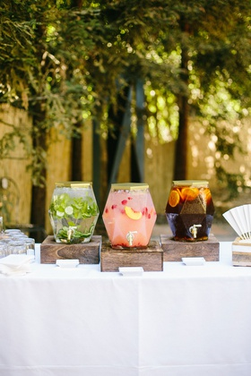 wedding drink station with wood box cucumber mint water peach strawberry lemonade iced tea gold