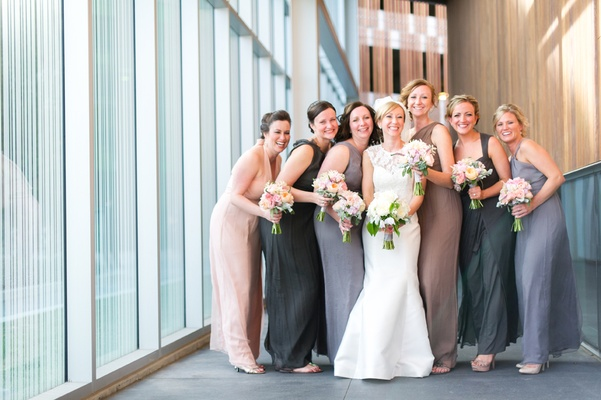 bridesmaids in mismatched gray and pink gowns