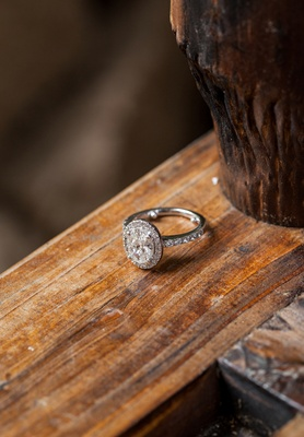Ring with halo setting and diamonds on band