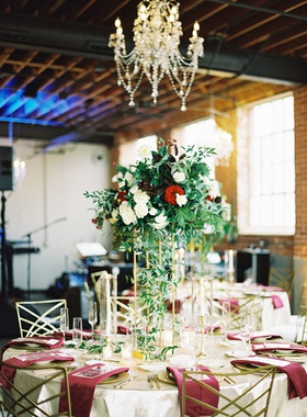wedding reception industrial denver venue brick wall winter greens deep reds burgundy gold reception
