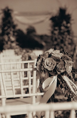 Black and white photo of wedding ceremony flowers