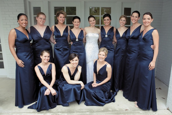 Dark colored gowns with silver brooches