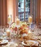 Wedding reception at The Breakers with low centerpiece rose, lisianthus, berry, candles and berries