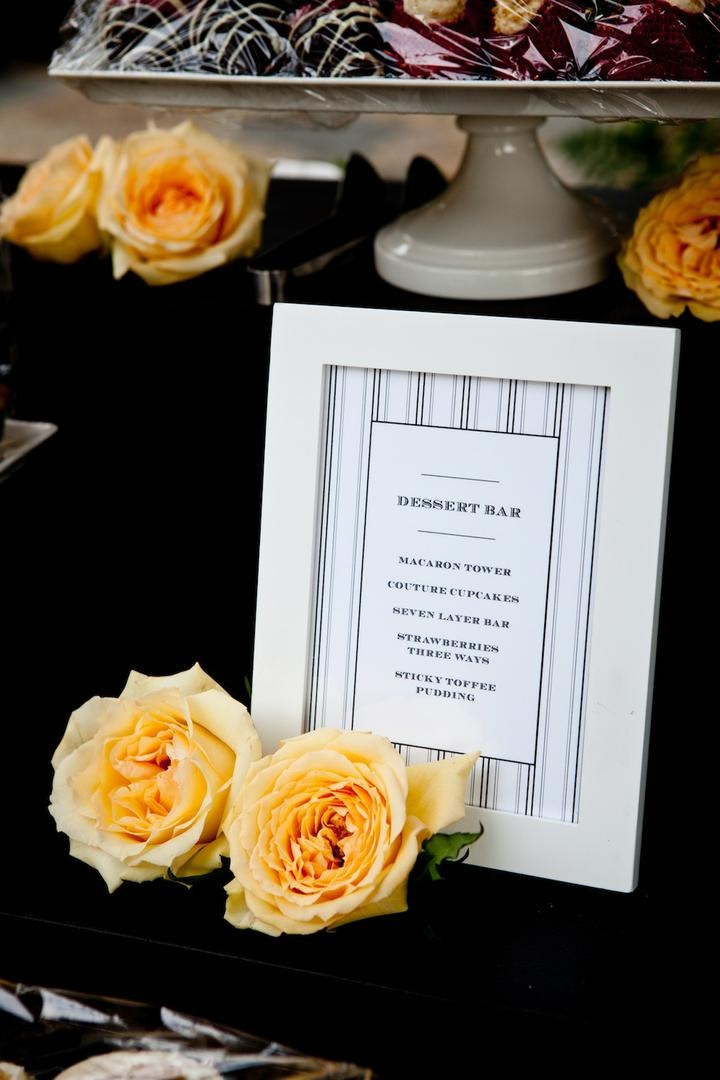 Striped dessert menu at wedding with yellow roses