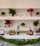 kentucky derby themed bridal shower, bar with garland held by blue ribbons, red and pink roses