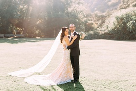 bride and groom at calamigos ranch wedding venue in malibu calla blanche wedding dress veil sunlight