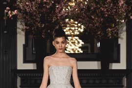 Ines Di Santo Spring 2019 collection high low ball gown with ruffles tiers and cathedral tra