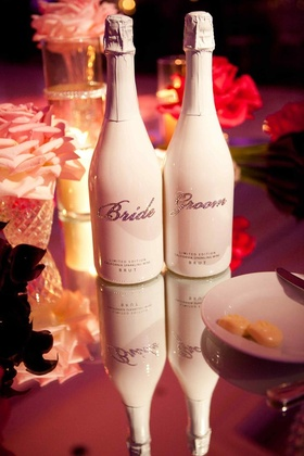 White sparkling wine bottles with Bride and Groom bling rhinestones