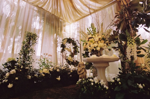 White flowers and plants under white draping