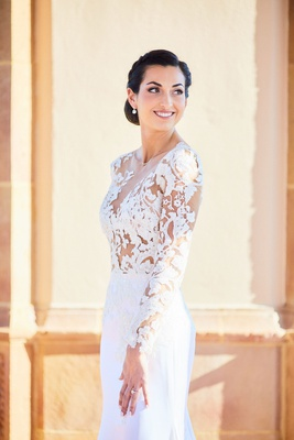 bride in pronovias wedding dress with lace bodice, crepe skirt, low updo with braids, natural makeup