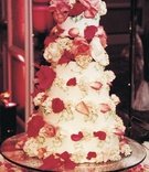 Five tier confection with roses and hydrangeas