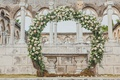 the ocean club, four seasons bahamas wedding ceremony in front of the cloisters, round floral arch