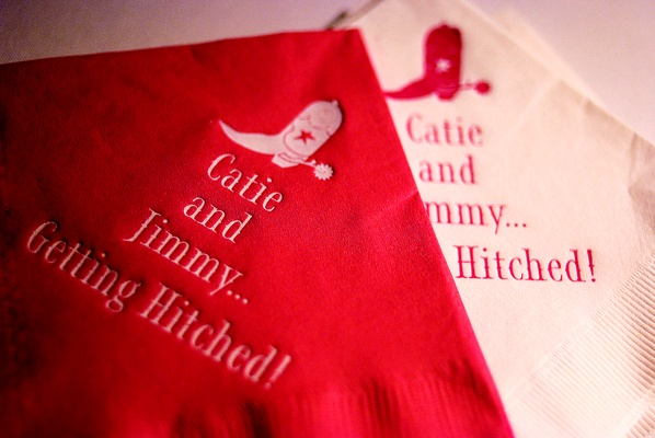 Red and white napkins with cowboy boot and spur motif