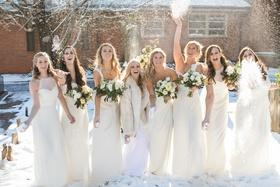 bridesmaids in cream amsale gowns throw snowballs