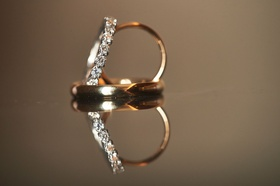 wedding rings detail shot gold men's room with eternity band diamonds